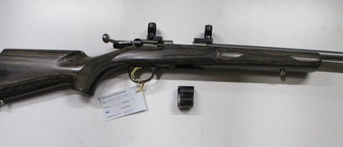Browning T bolt Stainless Laminate bolt action rim fire rifle in 22LR