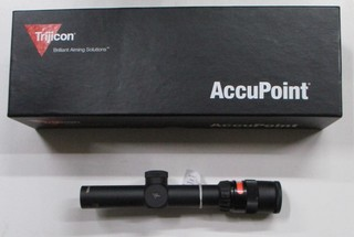 Trijicon Accupoint TR24R 1-4x24 variable power scope